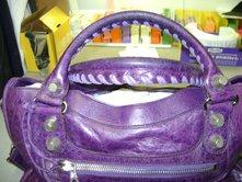 Balenciaga handbag before oil extraction of handles.